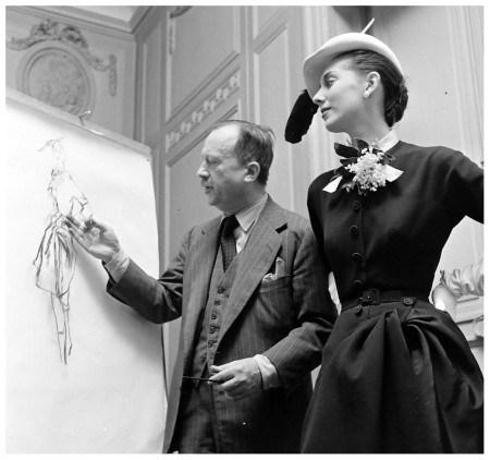 "Fashion illustrator Carl ""Eric"" Erickson with Marie-Thérèse model in a design by Balmain, photo by N.R. Farbman, February 1951"