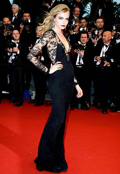 Cara Delevigne in a black lace Burberry gown