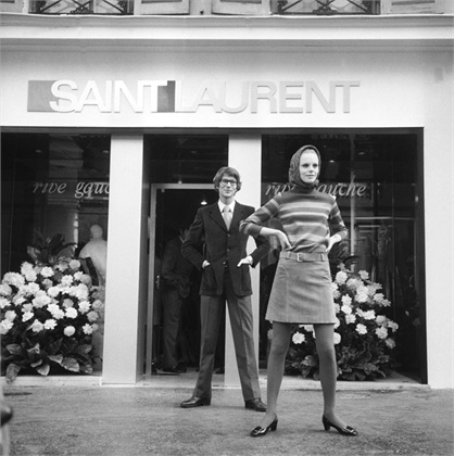 YSL posing outside the store with a model in Rive Gauche miniskirt dress