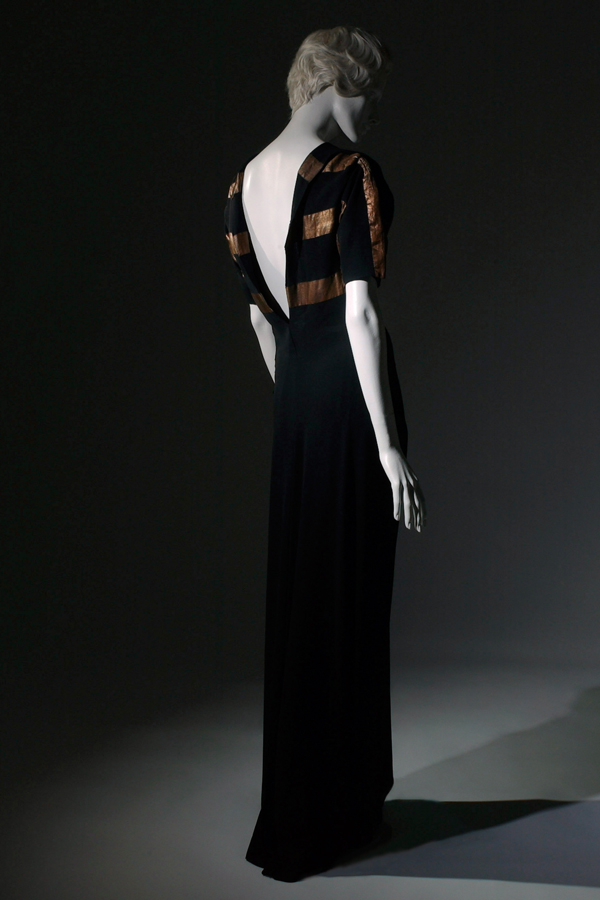 Augustabernard, black crêpe and lamé V-back gown, 1933, France, The Museum at FIT, 70.57.65, gift of Mr. Rodman A. Heeren