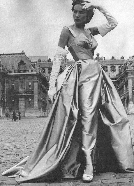 1951. Christian Dior. Silk taffeta evening gown w/ jewel @ bust worn with opera length evening gloves. Paris