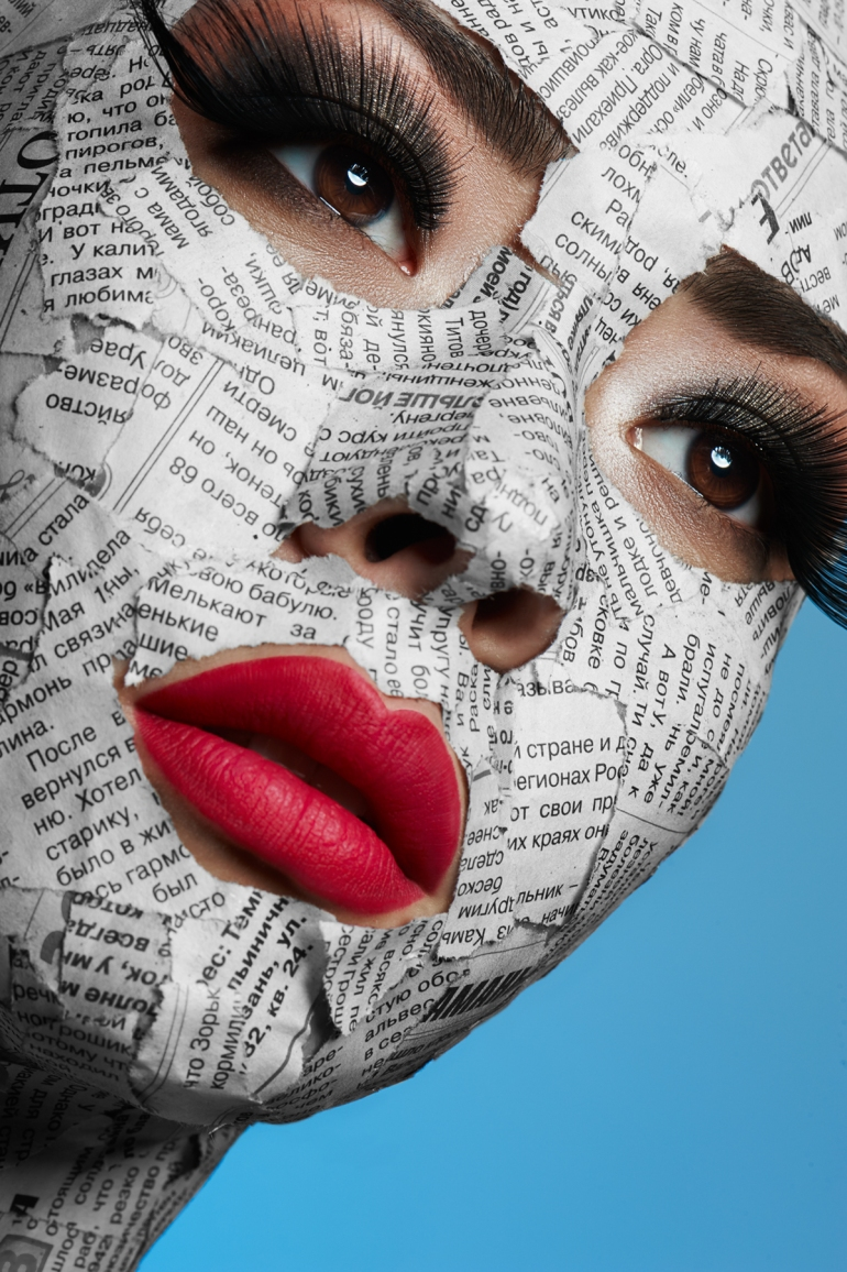 Female model with Newspaper on Face