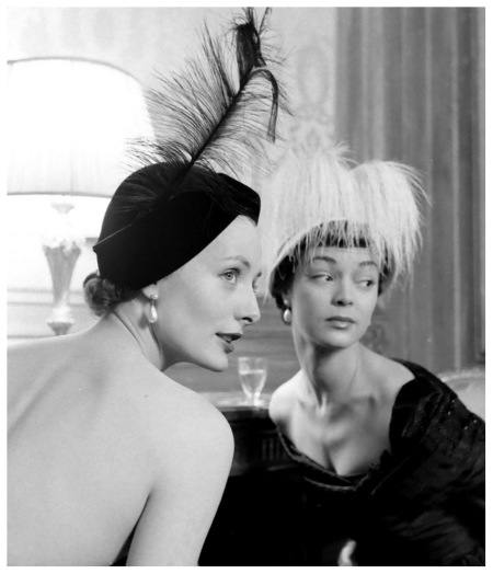 Lucille-Lewis-and-Jean-Patchett-wearing-feathered-hats-by-Sally-Victor