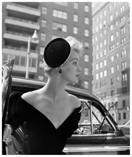 "Model-is-wearing-a-black-velvet-jeweled-cocktail-hat-by-Chanda-that-stays-put-with-new-""feathercomb""-gadget1953"