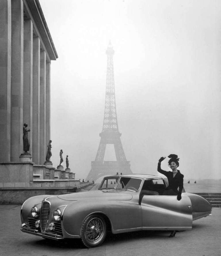 Model-is-wearing-a-Jacques-Fath-ensemble-posing-beside-a-1947-model-Delahaye-automobile.-884x1024