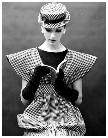 Simone-D'Aillencourt-in-a-broad-shouldered-pinafore-of-checks-worn-over-a-black-sheath-by-Traina-Norell
